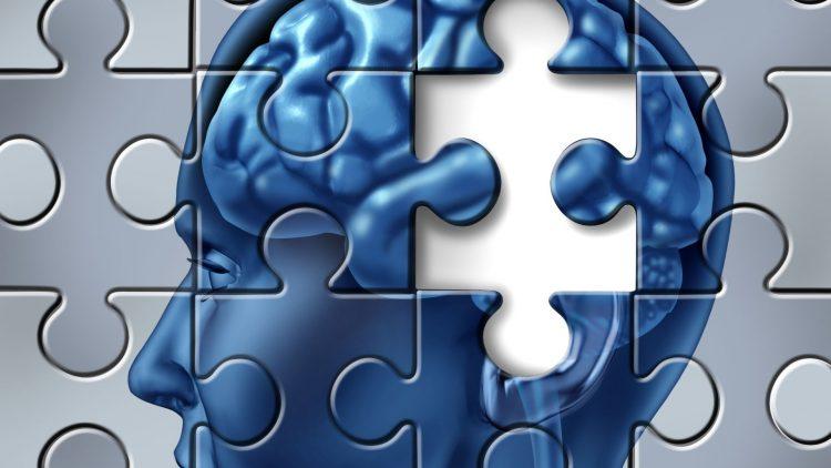 Puzzle mit Kopfbild mit fehlendem Puzzleteil